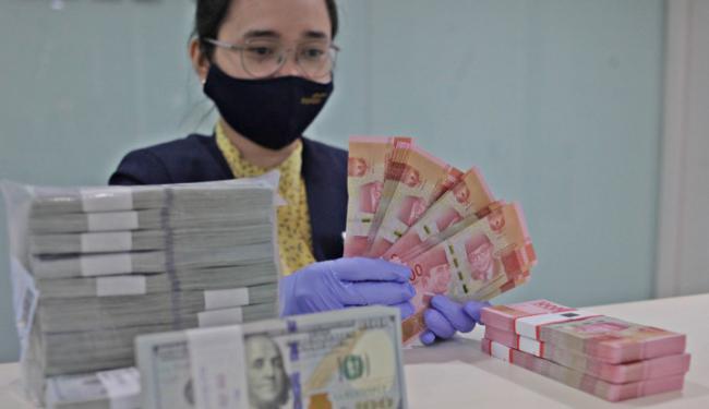 Dorong Dolar AS ke Bawah Rp14.100, Rupiah Terbaik Ketiga Se-Asia